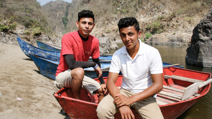 Edwin Montoya López and Josué Marcelino Zamora give a boat tour in Somoto Canyon National Park in Nicaragua. They formed their own business with a friend, Somotana Tours, after participating in CRS' Jovenes Constructores (YouthBuild) program.