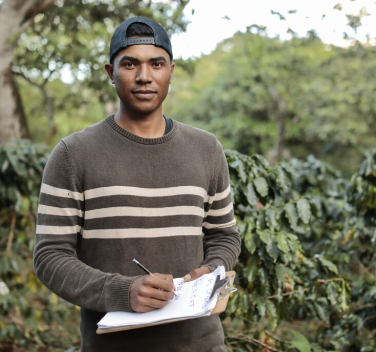 Portrait of Bayron Alejandro Cazún Castro, 26, incharge of Communications and business relations of Raindrop a youth business in charge of agriculture landscape restorations and moisture measurements seen at San Reymundo Coffee Estate, in Ahuachapán, El Salvador that belongs to a cooperative that works with RAICES AHUACHAPAN project.