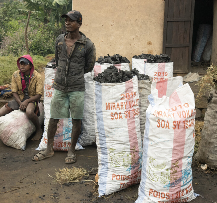 Charcoal is the main cooking fuel in Madagascar and its production has depleted forests and left many species of plants and animals threatened. These bags of charcoal will sell for about $3 each. Photo by David Snyder/CRS.