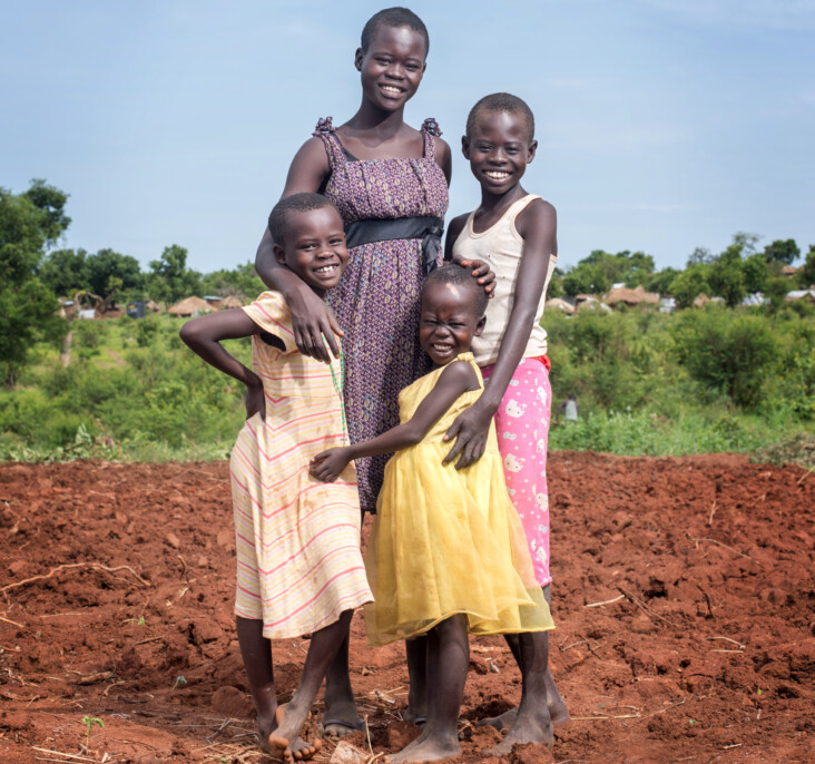 Annet Konga, still just a teenager, has been the head of her household since her parents died in 2012. In 2016, Annet and her siblings were forced to flee civil war in her native South Sudan. They are now living in the Bidi Bidi settlement in Northern Uganda. Photo by Philip Laubner/CRS.