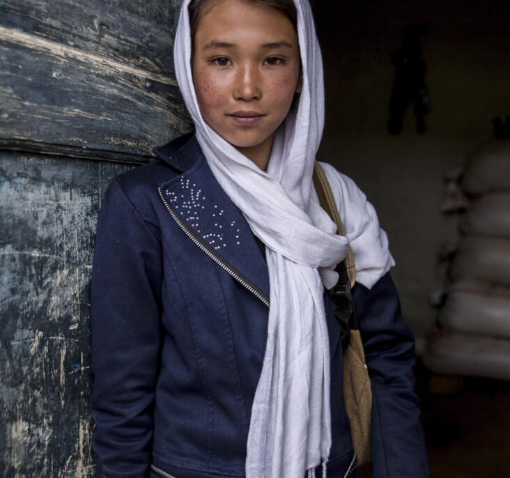 Rahna, 10, attends a CRS-funded school near her home in Ghor Province, Afghanistan. Community-based education matters in rural towns like Rahna's, where the nearest government school is more than five miles away. It is only accessible by crossing dangerous mountains where wild dogs and wolves live, or by following the main road where children often get hit by cars. Photo by Stefanie Glinski for CRS