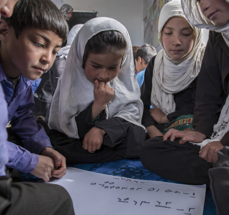 Children study at a CRS-established school in rural Afghanistan. This village is home to 45 families, many of which had never attended school before. Community-based education is essential in rural Afghanistan, as it otherwise often means that no education at all is available. Photo by Stefanie Glinski for CRS