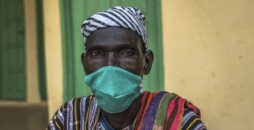 Chief representative and the elder of Tinguri Community Seidu Adam (65) wears a cloth face mask at Tinguri Health Clinic in Tinguri, Northern Ghana during the COVID-19 pandemic on June 15, 2020.