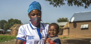 """Rahi Awudu (29) and her son at Bugyapala community, Northern Ghana on June 16, 2020. Rahi is a member of CRS initiative IMBC program that aims to support pregnant women and mothers with children under two years of age to become more resilient, decrease the risk for future depression, and manage daily stress effectively. """"Before the IMBC program if I don't have money to send my child to the hospital I will get very worried. Now I can attend the meetings and seek help from this program. When my child is healthy I am healthy""""."""