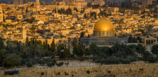 Scenes from old city of Jerusalem. Dome of the Rock, and the wall around old Jerusalem.