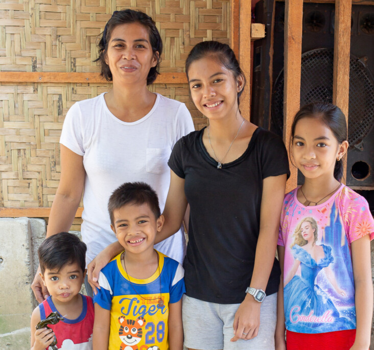"""Girli is relieved her new home will offer security to her family—including children Claire Ann, Jielie Mae, Joshua, and Johnson. """"I can now focus on my kids. I know I'll be able to keep them safe,"""" says Girli. Photo by Jennifer Hardy/CRS."""