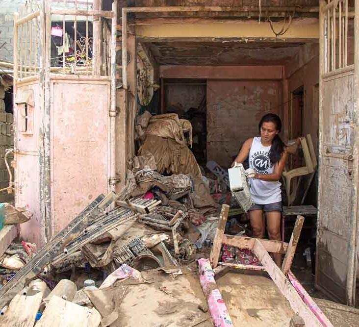 Woman in rubble.